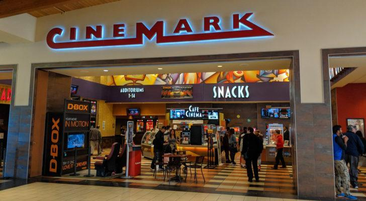 A Cinemark (CNK) movie theater with customers around the entrance